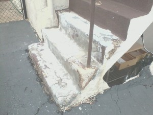 Before Photo of Concrete Step Repair