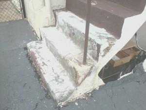 Before Photo of Concrete Step Repair