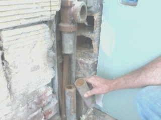 Before Installing the Cabinets I checked the Drain Pipe and  found that it was clogged.  We then replaced the entire Drain pipe and Vent Stack for the plumbing in the Kitchen.