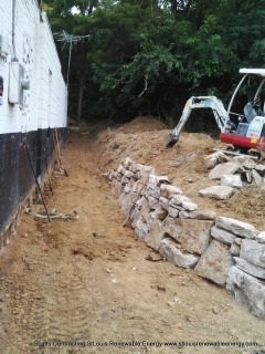 Roughly 2 ft x 6 ft of Dirt was removed for preparation of the Natural Stone Retaining Wall.
