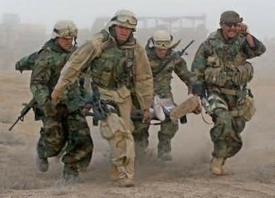 US Soldiers saving fellow soldier in battle over OIL